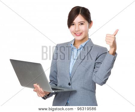 Young asian businesswoman use of the notebook computer and thumb up