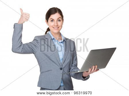 Young businesswoman hold with notebook computer and thumb up