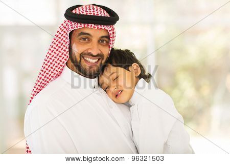 lovely Arabian father holding his sleeping baby