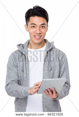 Young man use of the tablet pc