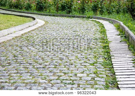 Park Walkway Of Paving Stones.