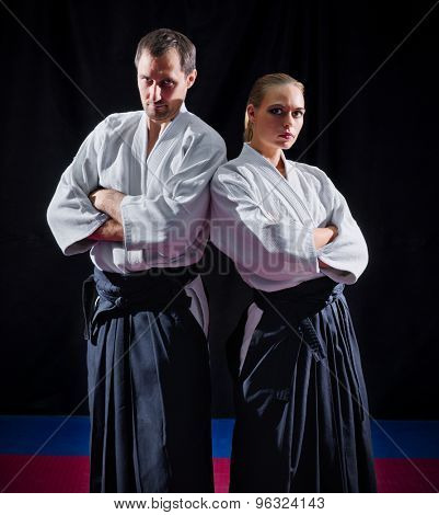 Two aikido fighters on black