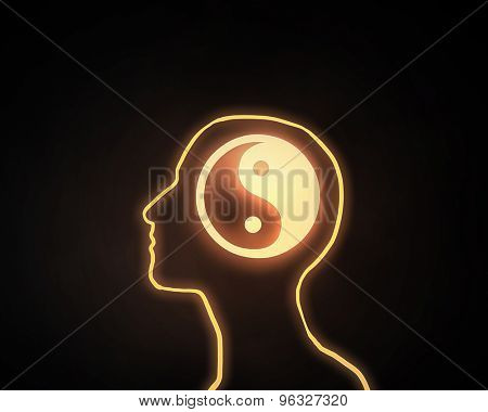 Human head with yin yang icon on dark background