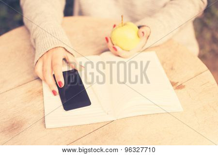 Young Girl With Cell Phone, Diary And Green Apple, Vintage Photo Effect