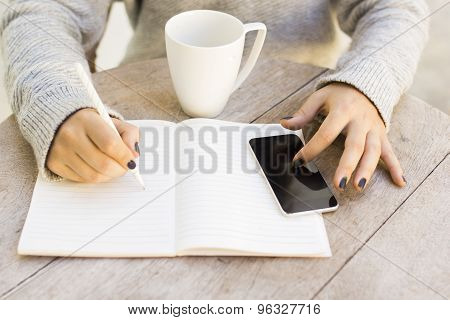 Girl With Cell Phone And Diary