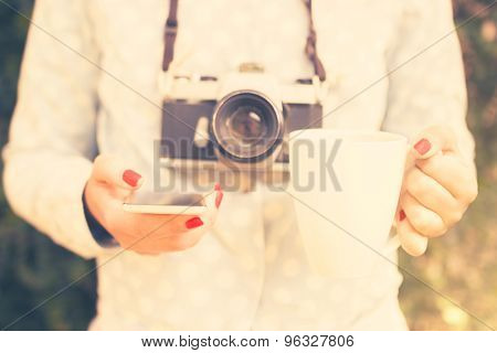 Girl With Cell Phone, Cup Of Coffee And Old Camera, Vintage Photo Effect
