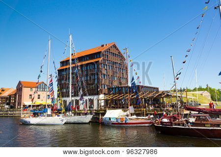 KLAIPEDA - JUNE 09: Yachts in Klaipeda Old Castle Harbour on June 09, 2015 Klaipeda, Lithuania. The Old Castle Harbour situated in a territory of 'Klaipeda ship repair yard'.