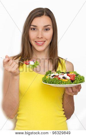Woman eating healthy food, Greek salad