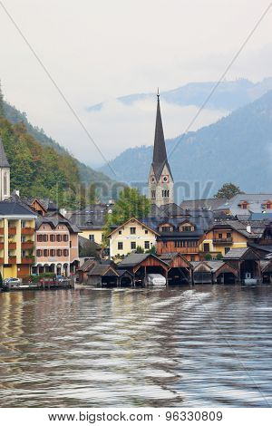 Hallstatt - the most beautiful small town in Austria at sunset. The picture was taken on board a pleasure boat