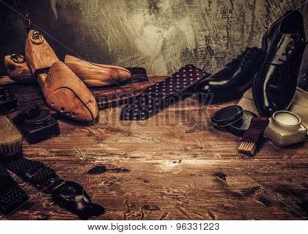 Shoe care and gentleman's accessories on a wooden table