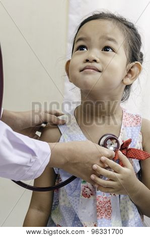 pediatrician and a child