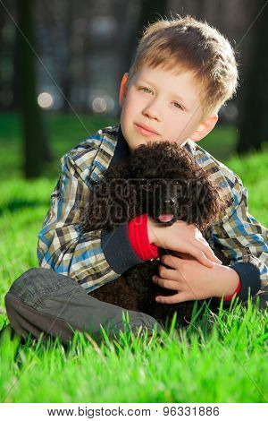 The boy with black poodle