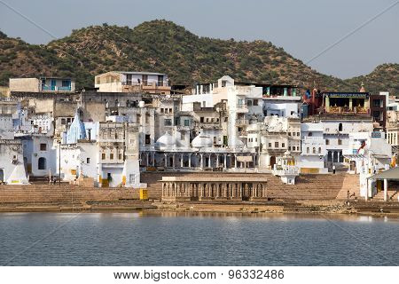 Holy ghats at sacred Sarovar lake. Pushkar - famous worship place in India