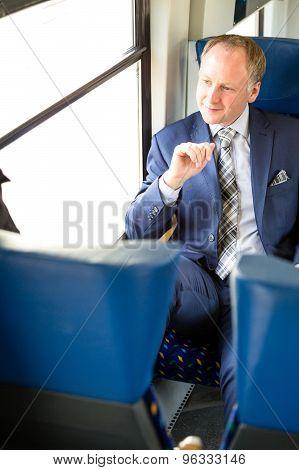 Businessman Enjoying His Train Journey