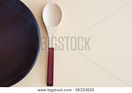 Wooden Spoon And Empty Plate From Above - Studio Shot