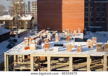 Pallets Of Bricks Winter Construction In The City Center In Siberia