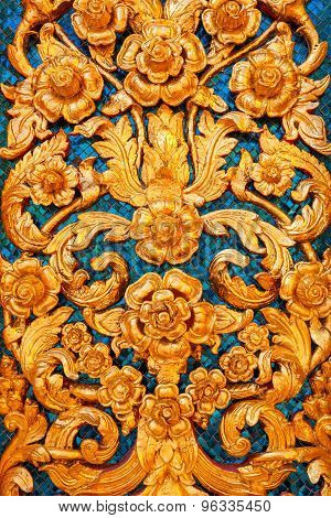 Low Relief of Thai Pattern Style on the Wall in a Thai Temple