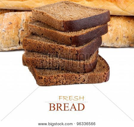 Sliced Rye Bread And Two Loaves Of Wheat Flour