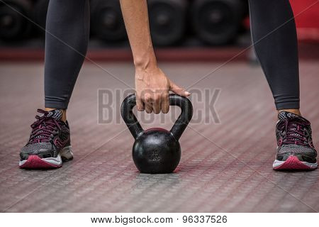 Young Bodybuilder doing weightlifting in the crossfit gym