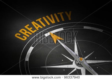 The word creativity and compass against black wall