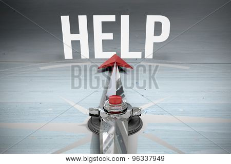 The word help and compass against bleached wooden planks background