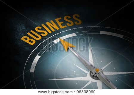 The word business and compass against dark background