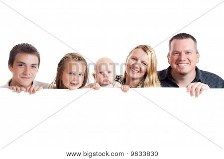 Happy Family Behind White Board