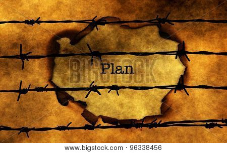Plan Text On Paper Hole Against Barbwire