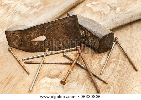 Old hammer, adze and rusty nails