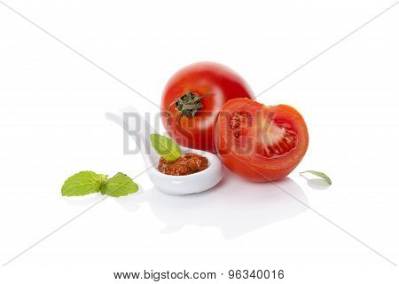 Fresh And Ripe Tomatoes And Red Pesto.