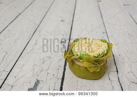 yellow artificial flowers on a gray floor