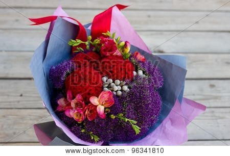 Bouquet of flowers in purple, burgundy, pink, crimson