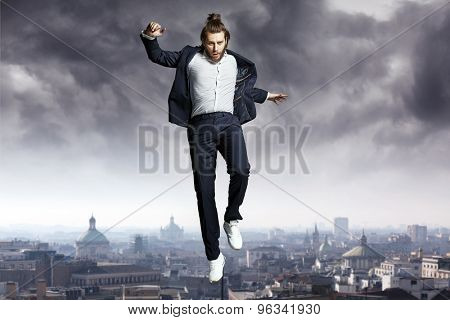 Fashion guy jumping to the sky