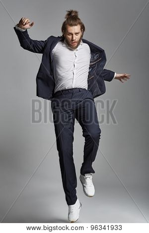 Elegant young guy jumping