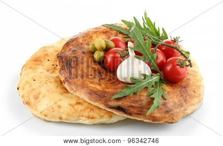 Pita bread and vegetables isolated on white
