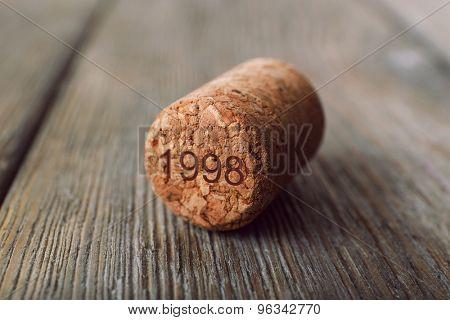 Wine cork on wooden background