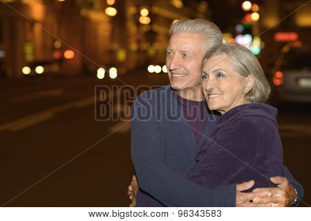 elderly couple and sunset background