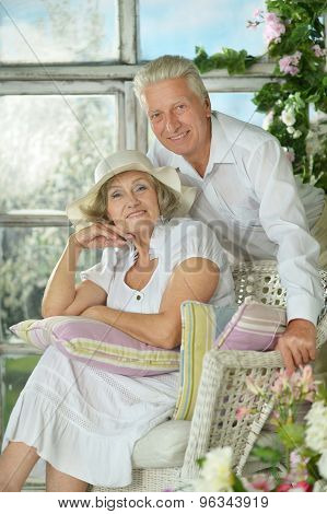 senior couple in garden on bench