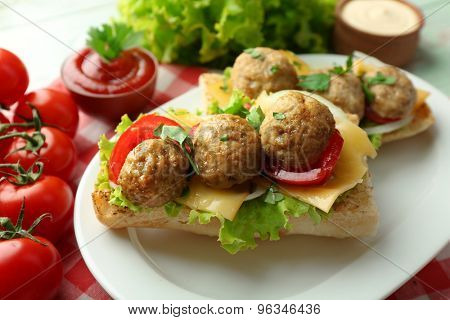 Meatball Sandwiches on wooden table background