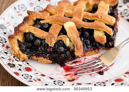 Piece Of Fresh Homemade Lattice Pie With Whole Wild Blueberries In White Plate With Fork