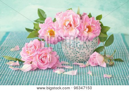 roses in a porcelain cup