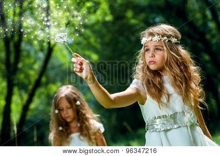 Girl Waving Magic Wand In Woods.