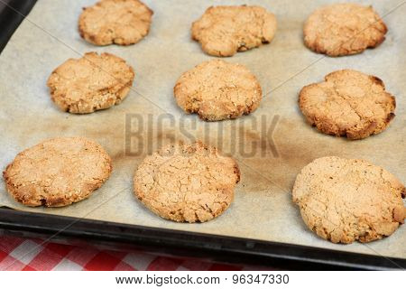 Homemade cookies on baking sheet close up