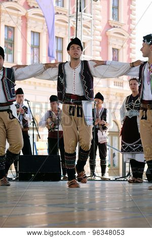 ZAGREB, CROATIA - JULY 19: Members of folk group Kitka from Istibanja, Macedonia during the 49th International Folklore Festival in center of Zagreb, Croatia on July 19, 2015