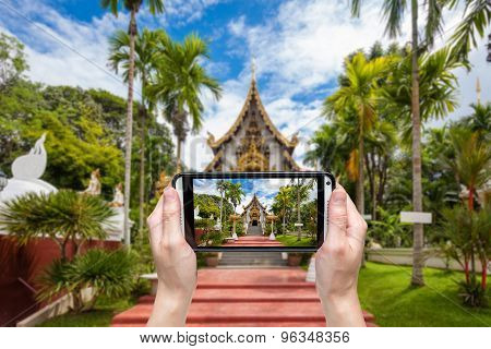 Hand Taking Photo At Wat Pha Dara Bhi Rom Temple