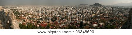 ATHENS, GREECE - OCTOBER 20, 2008: Mount Lycabettus rising over the historical centre in Athens, Greece. Panorama from the Acropolis of Athens.
