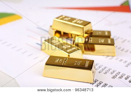 Gold bullion on documents background