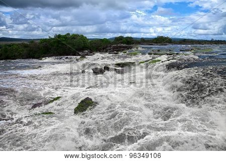 Powerful Water Stream At The Edge Of Waterfall