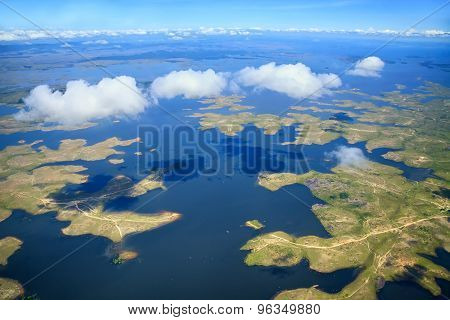 Aerial View To Archipelago Under Few Fluffy Clouds
