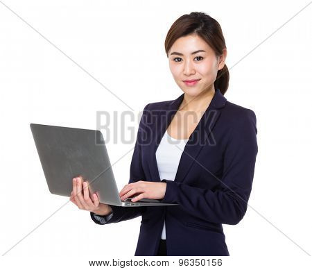 Businesswoman use of the laptop computer